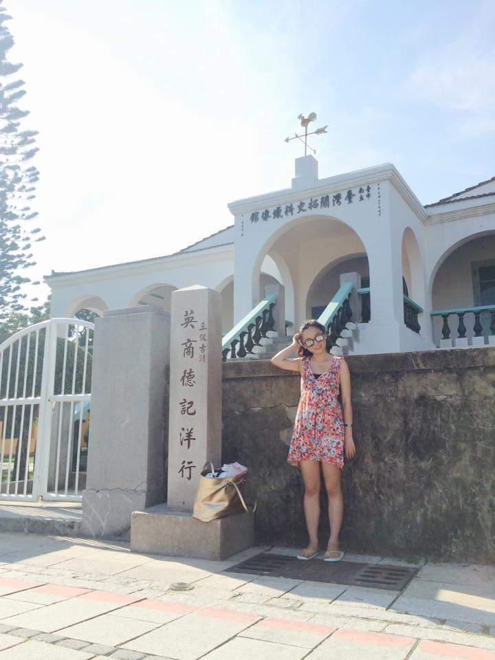 Girl posing in front of the colonial architecture at Former Tait & Co. Merchant House in Tainan