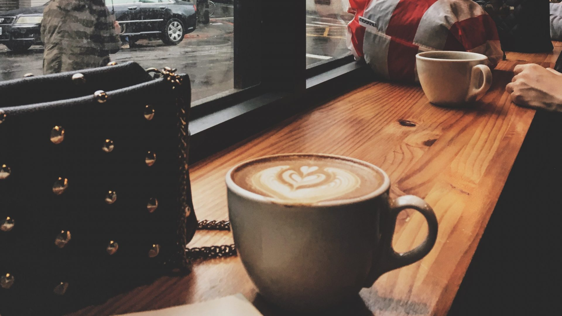 people watching with a cup of latte at Firewood Cafe in Taipei
