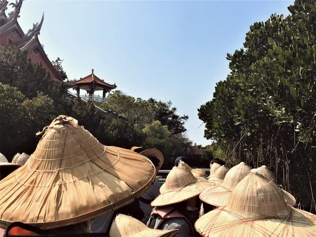 Passengers wearing bamboo hats onboard the boat tour around Sicao Green Tunnel in Tainan