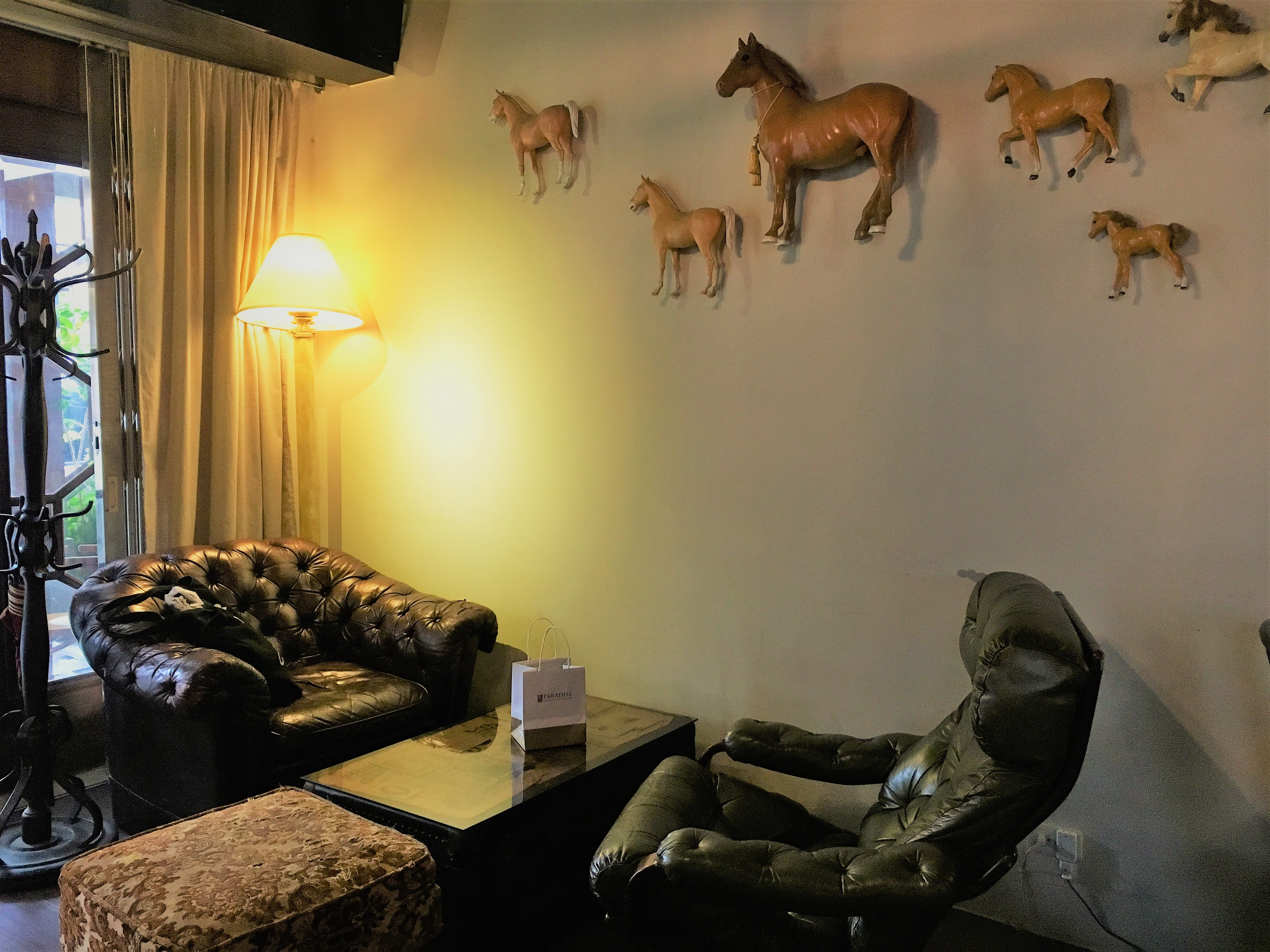 Eclectic decors on the wall of Modern Mode & Modern Mode Cafe in Dadaocheng, Taipei