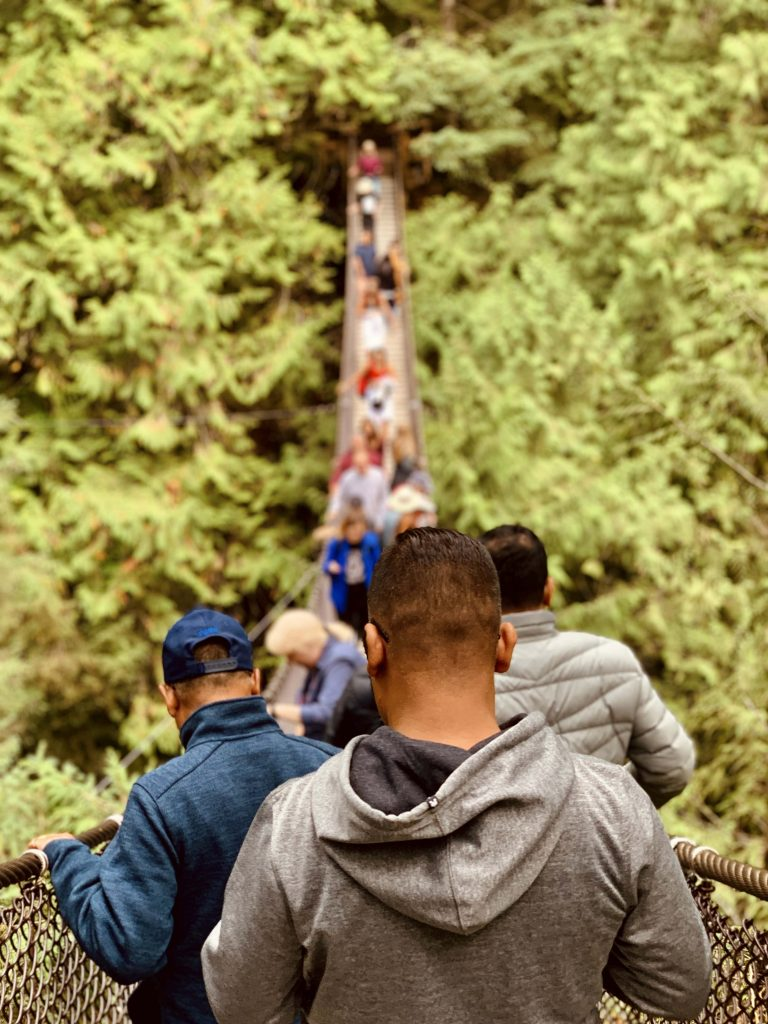 Visitors crossing the Lynn Canyon suspension bridge in North Vancouver