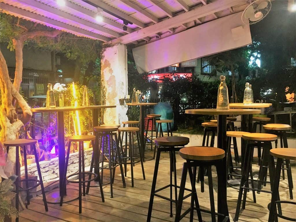 Outdoor seating at Home Coffee Roasting that serves alcohol in the evening
