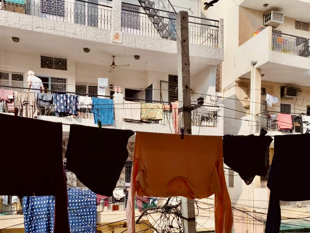 Clothes drying outside an apartment in Delhi