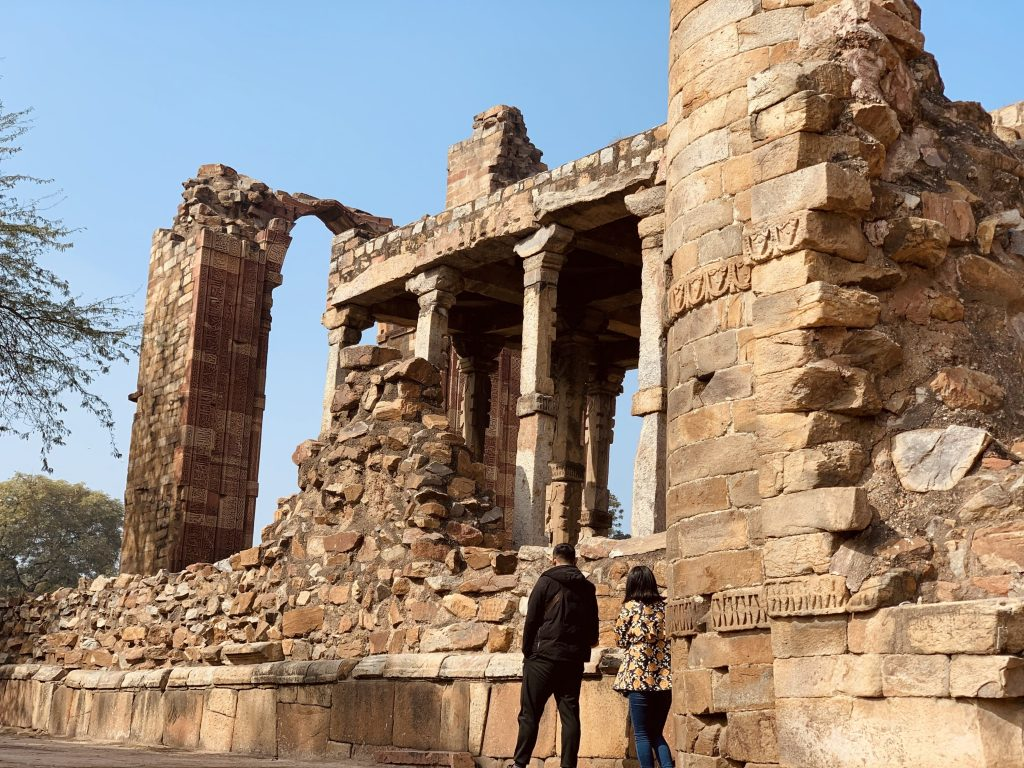 Couple walking in the ruins of Qutub Minar