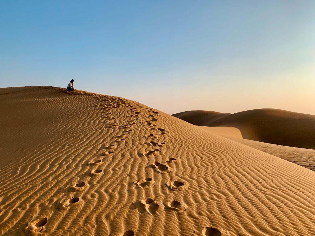 girl in thar desert on camel safari in rajasthan itinerary