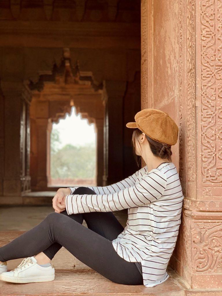 girl look into the intricate arches in fatehpur sikri